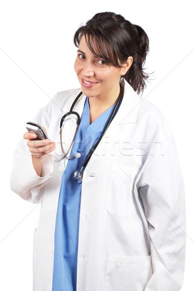 Female doctor send a SMS Stock photo © broker