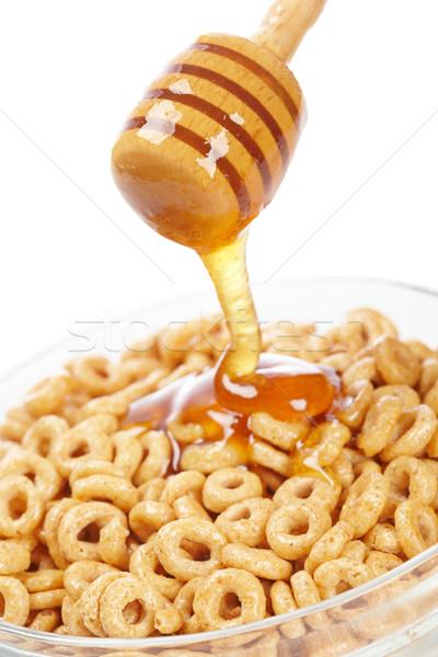 Pouring honey on cornflakes Stock photo © broker