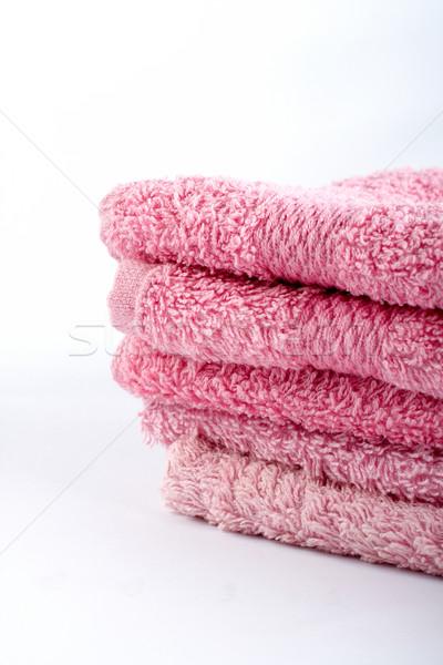 Rózsaszín törölközők egymásra pakolva fehér pihen fürdőszoba Stock fotó © broker
