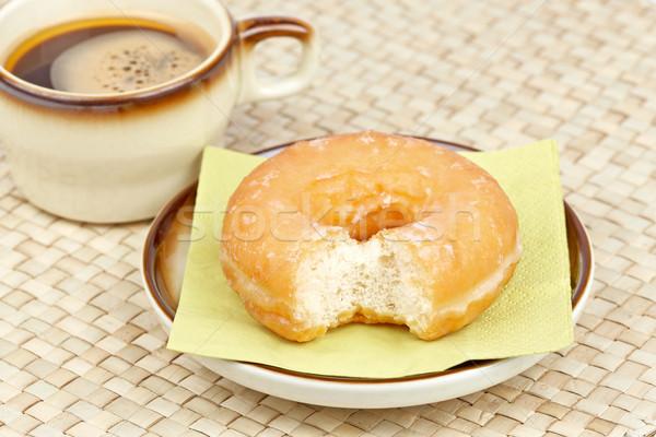 Donut bitten and coffee Stock photo © broker