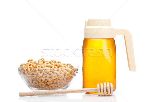 Honey pitcher and bowl of cereals Stock photo © broker
