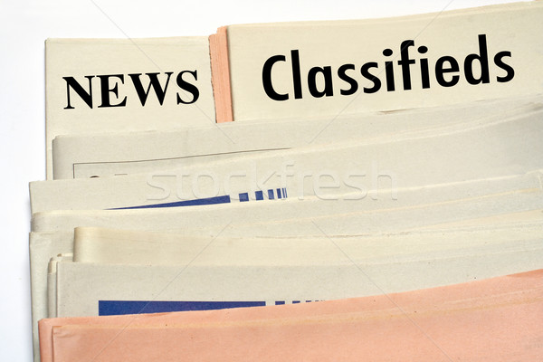 Stacked classifieds newspapers Stock photo © broker