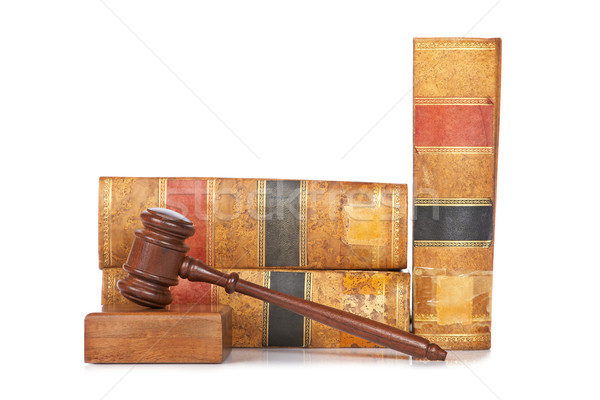 Wooden gavel and old law books Stock photo © broker