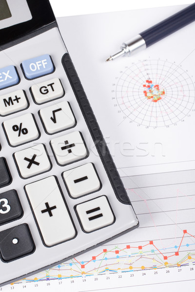 Calculator and pen on earnings chart Stock photo © broker
