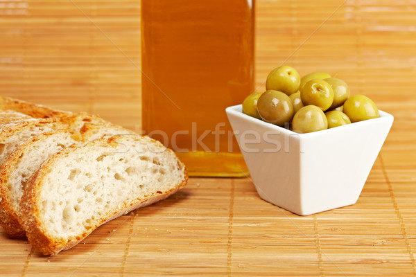 Bread, olive oil bottle and olives Stock photo © broker