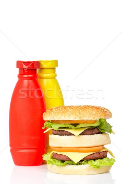 Raddoppiare cheeseburger senape ketchup bottiglie formaggio Foto d'archivio © broker