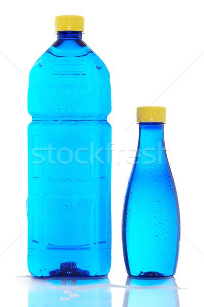 Kettő üvegek ásványvíz cseppek víz étel Stock fotó © broker