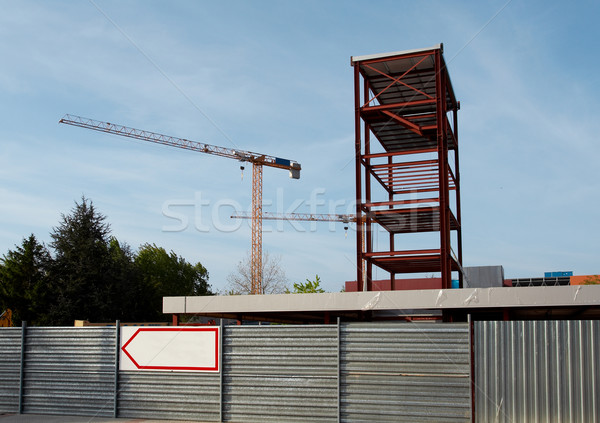Steel Structure and Construction crane set against a blue sky Stock photo © broker