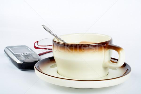 Kubek kawy łyżka wewnątrz telefon komórkowy Zdjęcia stock © broker