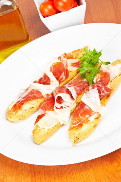 Fatias espanhol presunto saboroso pão branco Foto stock © broker