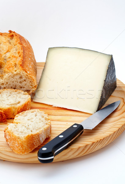 Cheese, bread and knife on wood plate Stock photo © broker