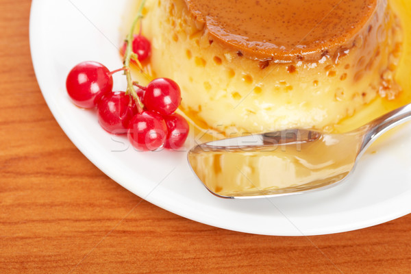 Cream caramel dessert with red currants Stock photo © broker