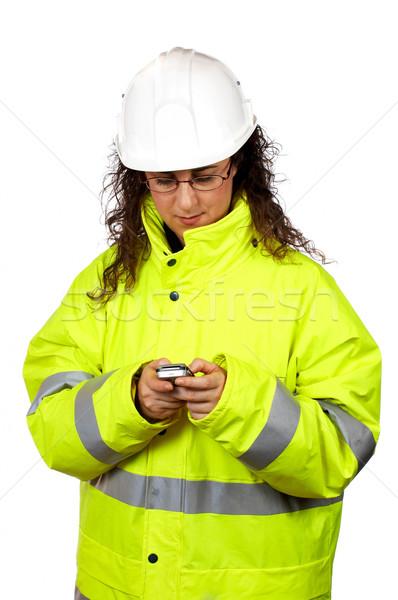 Női építőmunkás küld sms fehér nők Stock fotó © broker