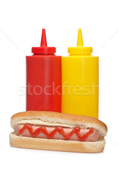 Hot dog with ketchup and mustard bottles Stock photo © broker