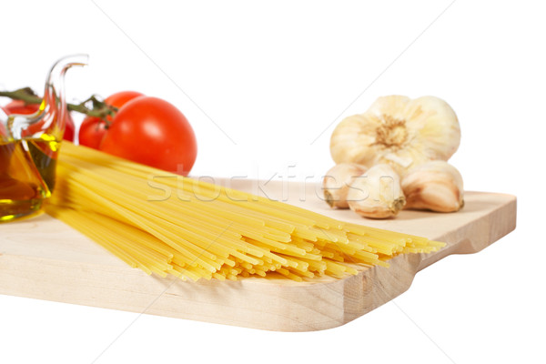 Tomatoes, olive oil, garlic and spaghetti Stock photo © broker