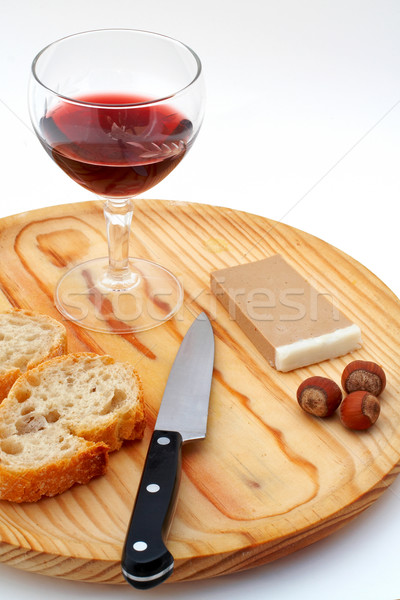 Stock photo: Pate, bread, glass of red wine, hazelnuts and knife on wood plat