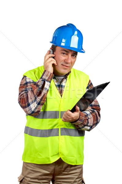 Bouwvakker praten mobiele telefoon groene telefoon Stockfoto © broker