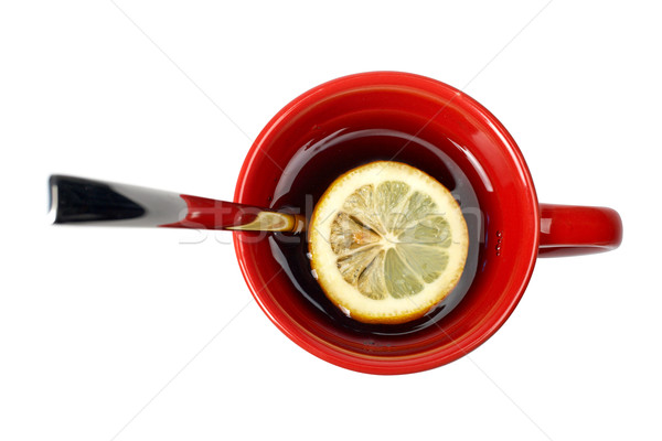 Red cup of tea with lemon and the spoon Stock photo © broker