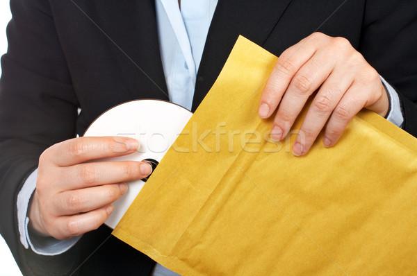 Put dvd disc on the envelope Stock photo © broker