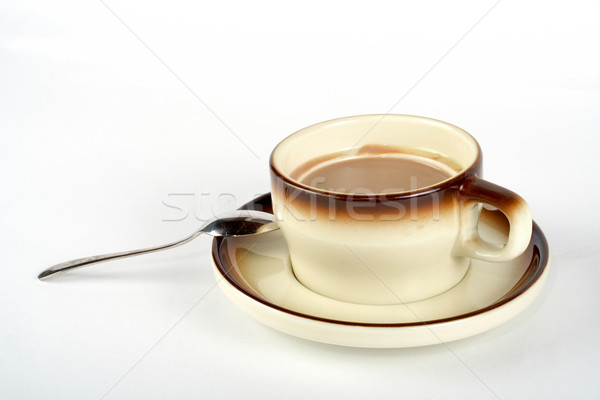 Close-up of a cup of coffee with the spoon, on ceramic plate Stock photo © broker