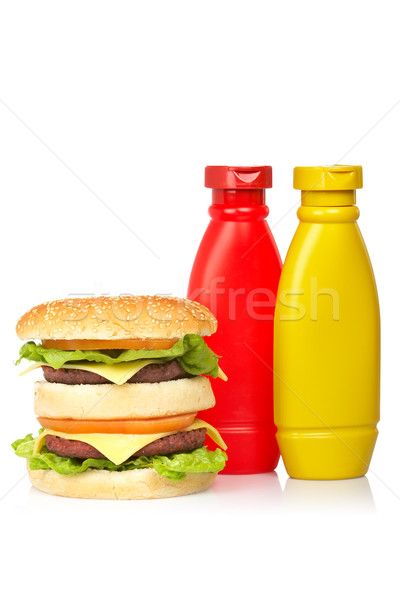 Doubler cheeseburger moutarde ketchup bouteilles blanche Photo stock © broker
