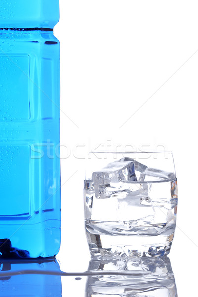 Bottle and glass of mineral water with droplets Stock photo © broker