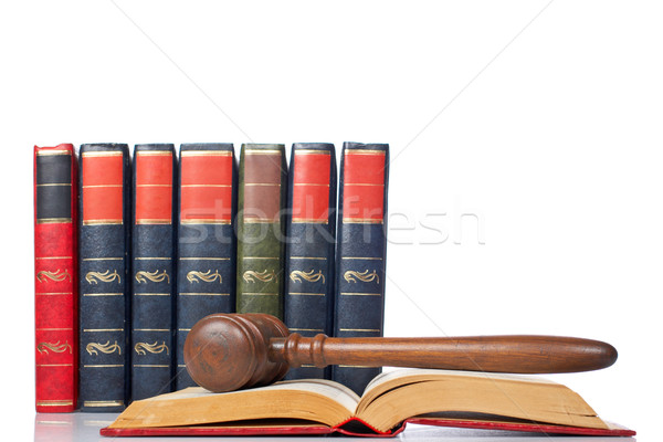 Gavel over the opened law book Stock photo © broker