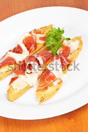 Fatias espanhol presunto saboroso branco prato Foto stock © broker