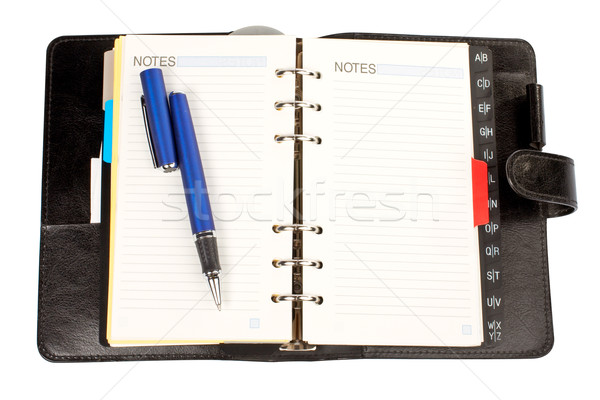 Opened agenda with the pen Stock photo © broker