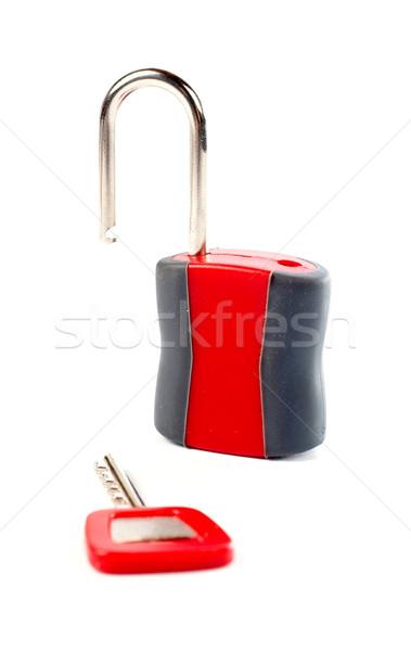 Unlocked padlock and the key Stock photo © broker