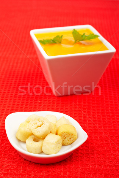 Bread croutons and carrots puree Stock photo © broker