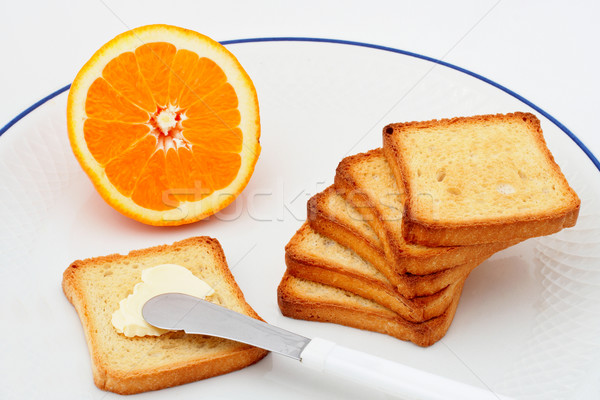Toast with butter and half orange Stock photo © broker