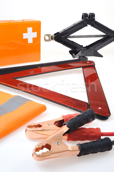 Emergency kit for car - first aid kit, car jack, jumper cables, warning triangle, reflective vest Stock photo © brozova