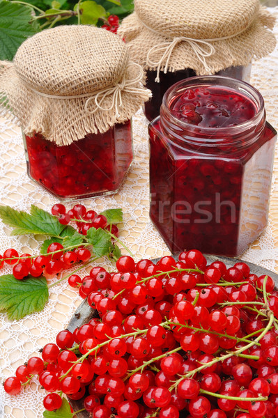 Jars of homemade red currant jam with fresh fruits Stock photo © brozova