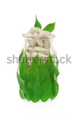 Сток-фото: травяной · таблетки · свежие · листьев · стекла