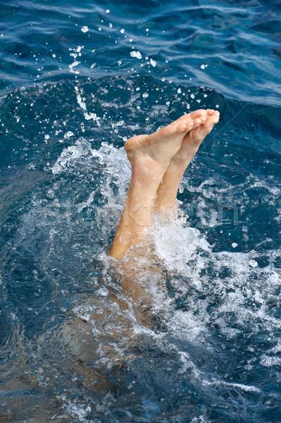 Young man jumping into water Stock photo © brozova