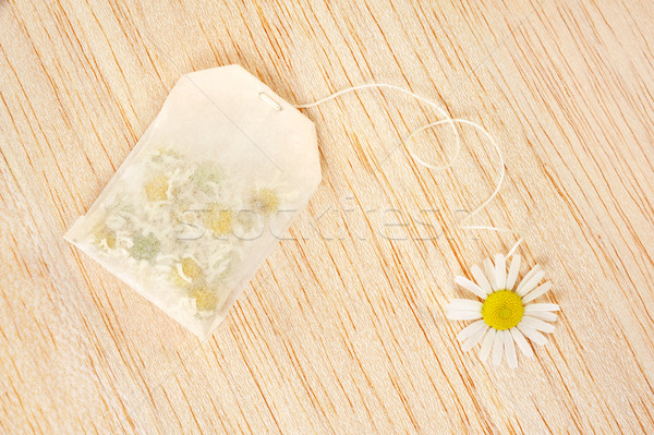 Bag of chamomile tea over wooden background - concept Stock photo © brozova
