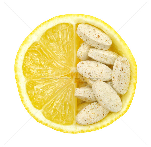 Close up of lemon and pills isolated – vitamin concept - vitamin c Stock photo © brozova