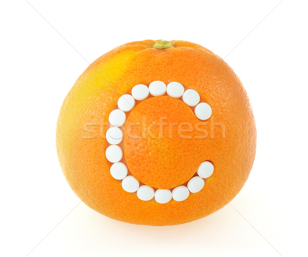 Grapefruit with vitamin c pills over white background - concept Stock photo © brozova
