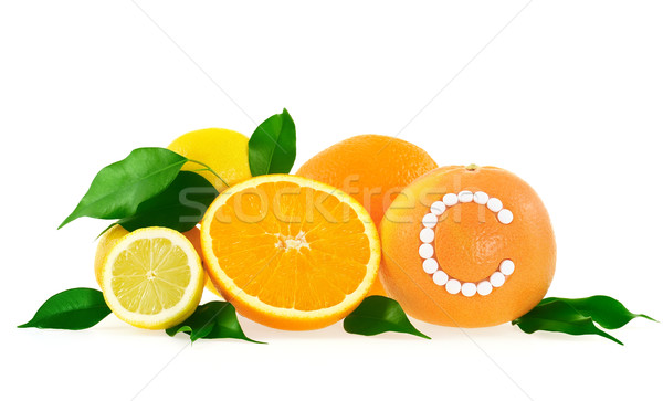 Orange, lemon, grapefruit with vitamin c pills over white background – citrus fruits concept Stock photo © brozova