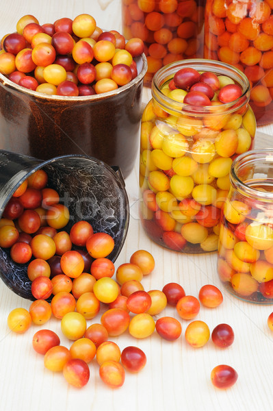 Preserving Mirabelle plums - jars of homemade fruit preserves – Mirabelle prune Stock photo © brozova