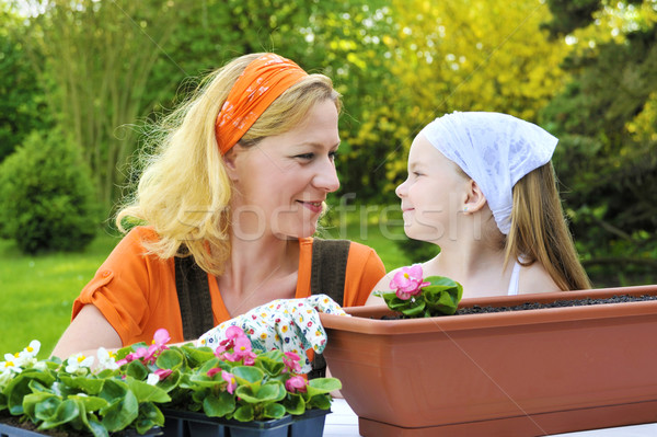 Mother and daughter having gardening time Stock photo © brozova