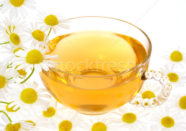 Cup of chamomile tea over white background Stock photo © brozova