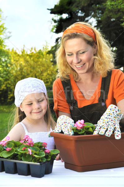 Young mother and her daughter having gardening time Stock photo © brozova