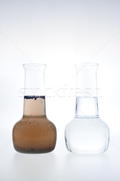 Stock photo: Sample of clean and dirty water isolated