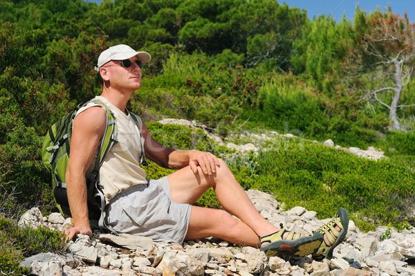 Outdoor man resting on rock after hiking, Croatia Stock photo © brozova