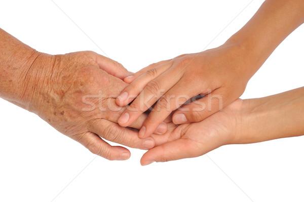 Eller genç kıdemli kadın el helping Stok fotoğraf © brozova