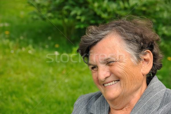 Senior woman smiling Stock photo © brozova