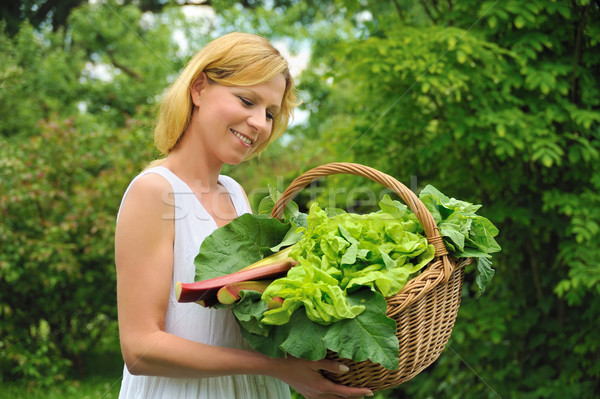 Young woman holding basket with vegetable Stock photo © brozova