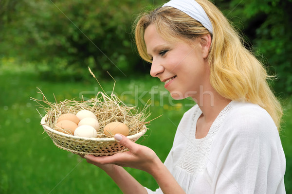 Young woman and Easter eggs Stock photo © brozova